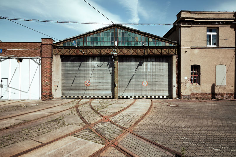 Old tram depot Historical Building Historical Monuments Public Transportation Road Service Tram Architecture Building Building Exterior Buildings Built Structure Cloud - Sky Day Depot Hall Historical Museum No People Outdoors Sky Street Street Photography Streetphotography Tracks Tramtracks