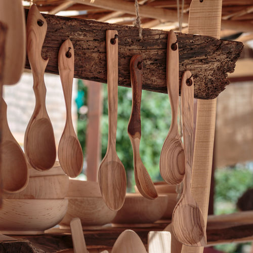 Close-up of wooden spatula hanging for sale