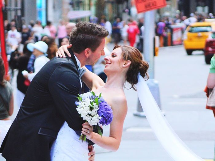 Side View New Married Couple Embracing On City Street