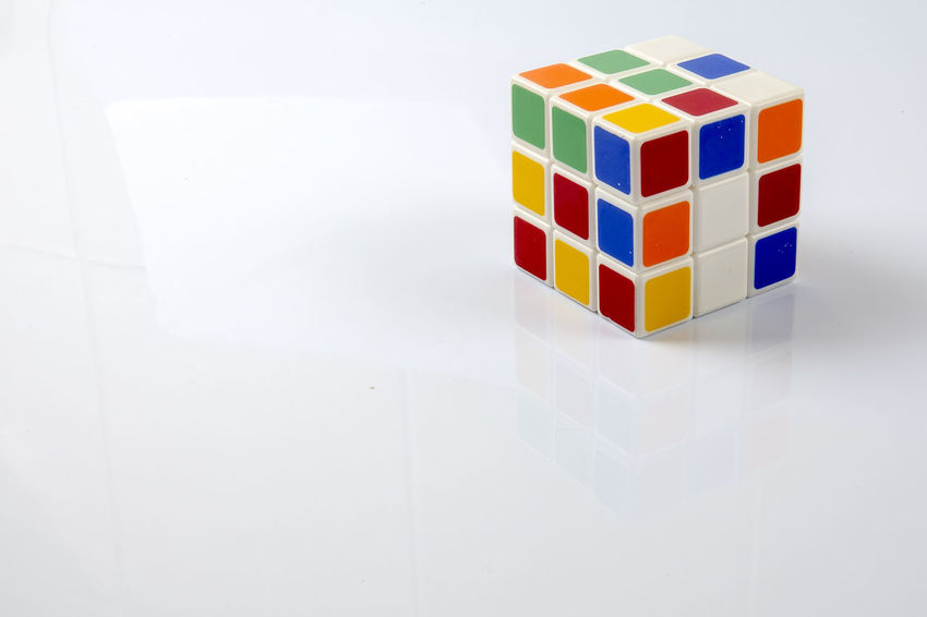 Rubik Cube isolated on white Close-up Creative Editorial Photography Illustrative Editorial Indoors  Intelligence Multi Colored No People Rubik's Cube Solution Concept White Background