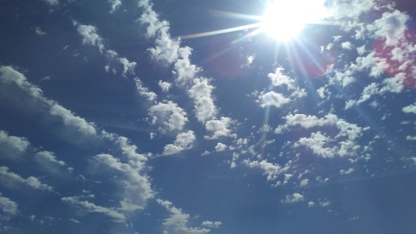 Sky Cloud - Sky Blue Sunlight Sun Low Angle View Cloudscape Sunbeam Beauty In Nature No People Outdoors Nature Day