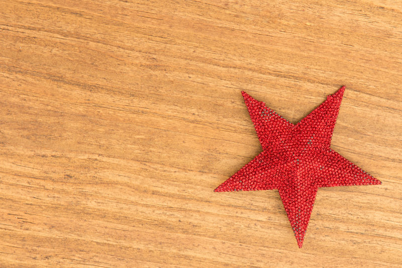 High angle view of star shape on wooden table during christmas