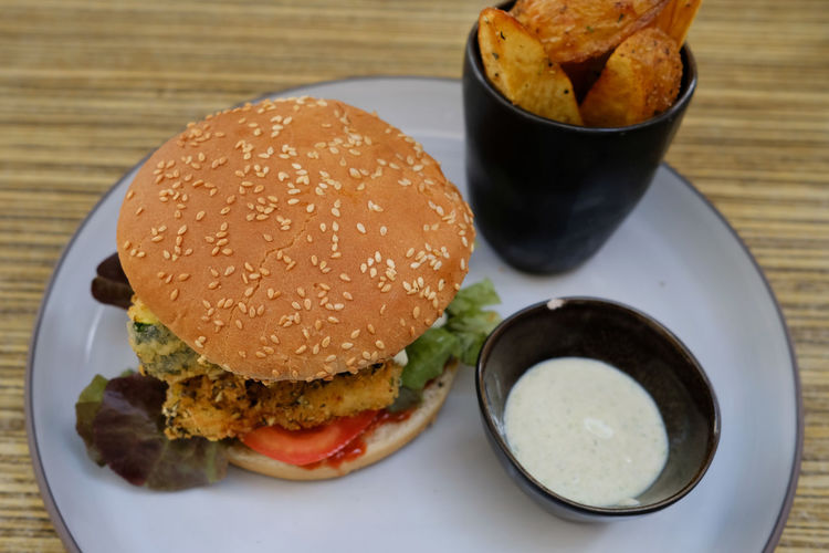 A veggie-burger on a plate. Vegetarian Food Bun Burger Close-up Day Fast Food Food Food And Drink Freshness Hamburger Indoors  Indulgence Lettuce Meat No People Plate Ready-to-eat Serving Size Table Unhealthy Eating Vegetable Veggie Food Stories