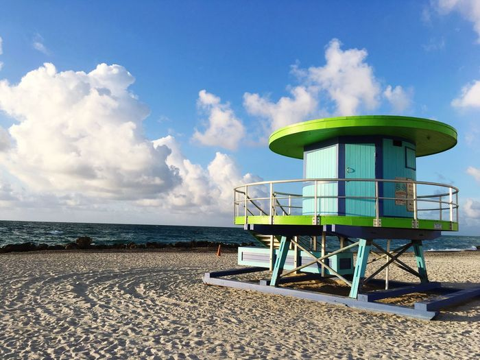 Beach Sand Cloud - Sky Sky Sea Horizon Over Water Water Sunlight Skyandclouds  Skyandsand Lifeguard Hut Lifeguard  Protection Safety Outdoors Day Tranquility Tranquil Scene No People Blue Miami Beach Florida Travel Destinations Vacations