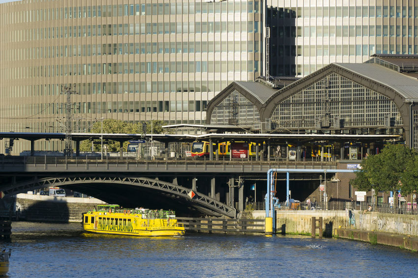 Friedrichstrasse Station with Spree River in Berlin, Germany Architecture Berlin Bridge - Man Made Structure Building Exterior Built Structure City Color Image Connection Day Friedrichstrasse Station Germany🇩🇪 Horizontal No People Outdoors Photography Public Transportation Railway Station River Cruise Boat Sightseeing Tour Skyscraper Spree River Berlin Train Transportation Water Yellow