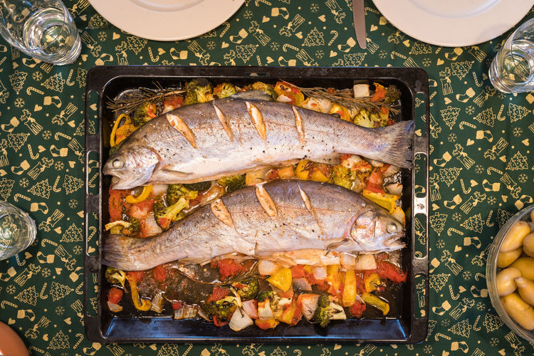 Two Salmons and oven-roasted vegetables ready to eat on a baking tray Food And Drink Food Freshness Ready-to-eat Seafood Indoors  Fish Meal Dinner Salmon Baking Sheet Baked Christmas Oven OvenBaked Oven Roasted Winter