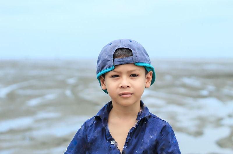 Portrait of boy wearing cap outdoors