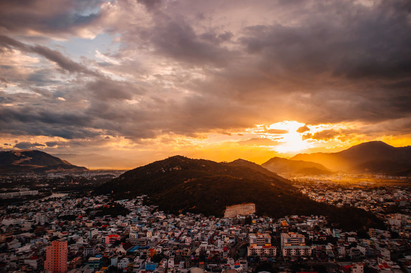 Nha Trang cityview on sunset Architecture Beauty In Nature Building Building Exterior Built Structure City Cityscape Cloud - Sky Community Crowd Crowded High Angle View Mountain Mountain Range Nature Outdoors Residential District Scenics - Nature Sky Sunset Town TOWNSCAPE