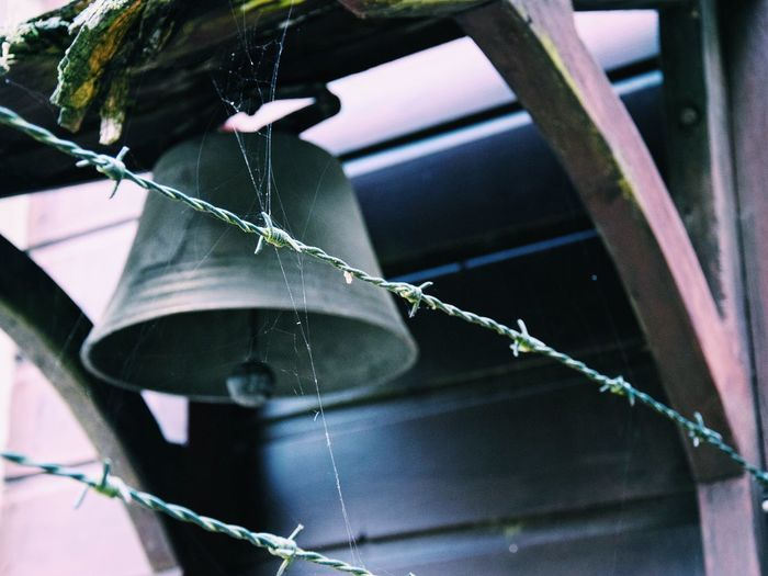 Close-Up Of Barbed Wires Against Bell