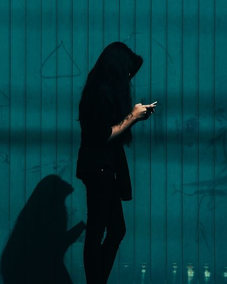 // on the phone // p.s it was such a great day shooting out the people in black dresses. Stay tuned for more of them. Tadaa Community Portrait Color Portrait Japan Photography EyeEm Best Shots ShotOniPhone6 IPhoneography Colors The Dark Square EyeEm