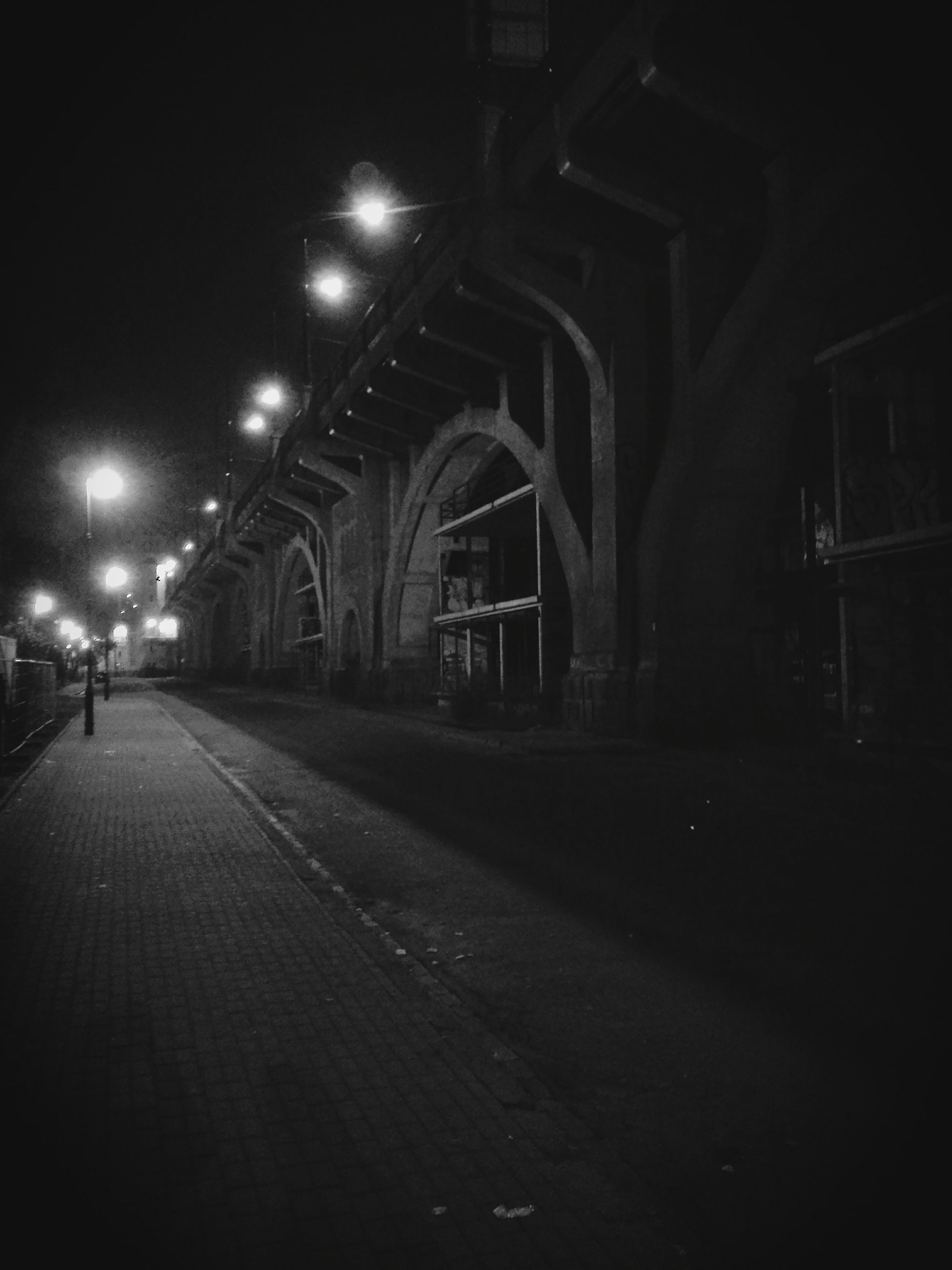 architecture, built structure, illuminated, night, the way forward, arch, building exterior, diminishing perspective, empty, architectural column, history, vanishing point, travel destinations, lighting equipment, long, walkway, indoors, street, incidental people, no people