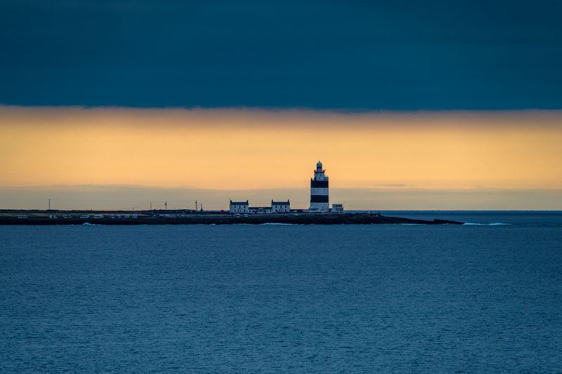 Hook Head, Ireland Architecture Building Building Exterior Built Structure Guidance Hook Head Light House Horizon Over Water Lighthouse No People Outdoors Protection Scenics - Nature Sea Security Sky Sunset Tower Water Waterfront