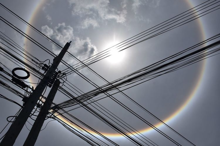 sun corona Beauty In Nature Cable Close-up Low Angle View Nature Photography Power Line  Power Supply Sky Sun Corona Under The Sun