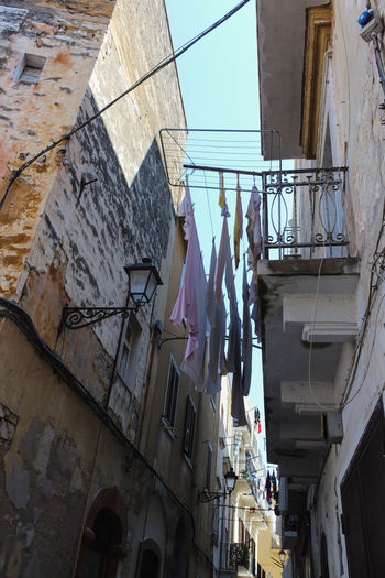 Low angle view of clothes drying on building