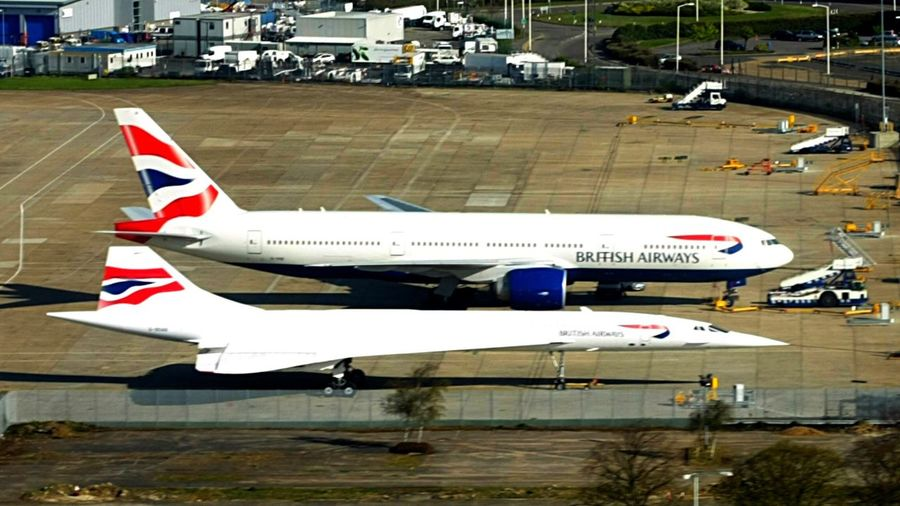 Concorde parked beside Boeing at Heathrow Concorde Suersonic Jet Boeing Transportation Fly Airplne British Airways Cool Technology Advanced High Speed Luxury Pointy Nose Heathrow Airport