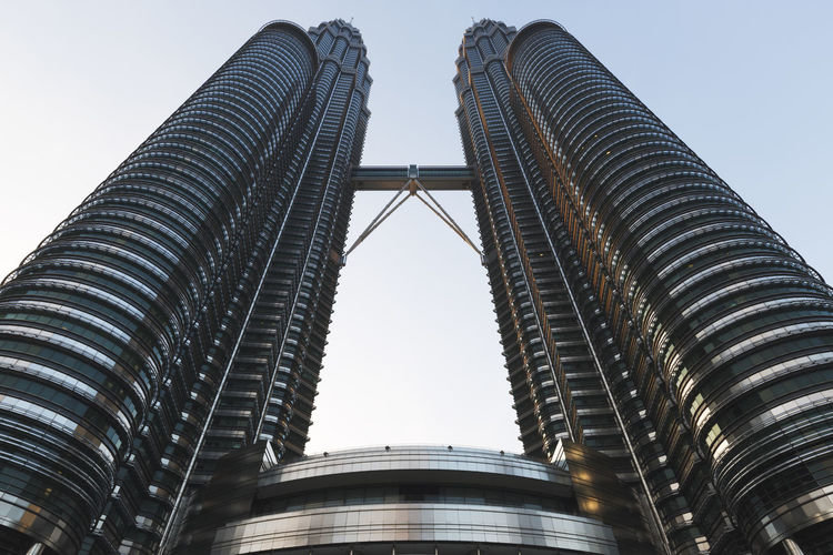 KUALA LUMPUR, MALAYSIA - MARCH 13, 2016: The Petronas Towers, also known as the Petronas Twin Towers are twin skyscrapers in Kuala Lumpur, Malaysia. Architecture Building Exterior Built Structure City Clear Sky Day Landmark, Kuala, Lumpur, Malaysia, Skyline, Cityscape, Klcc, Business, Architecture, Scene, Skyscraper, Travel, Downtown, Twin, Urban, Shopping, Tower, City, Capital, Asia, Modern, Building, Office, Petronas, Park, Famous, View, Tall, Center, Morning, Tal Low Angle View Modern No People Outdoors Sky Skyscraper Travel Destinations