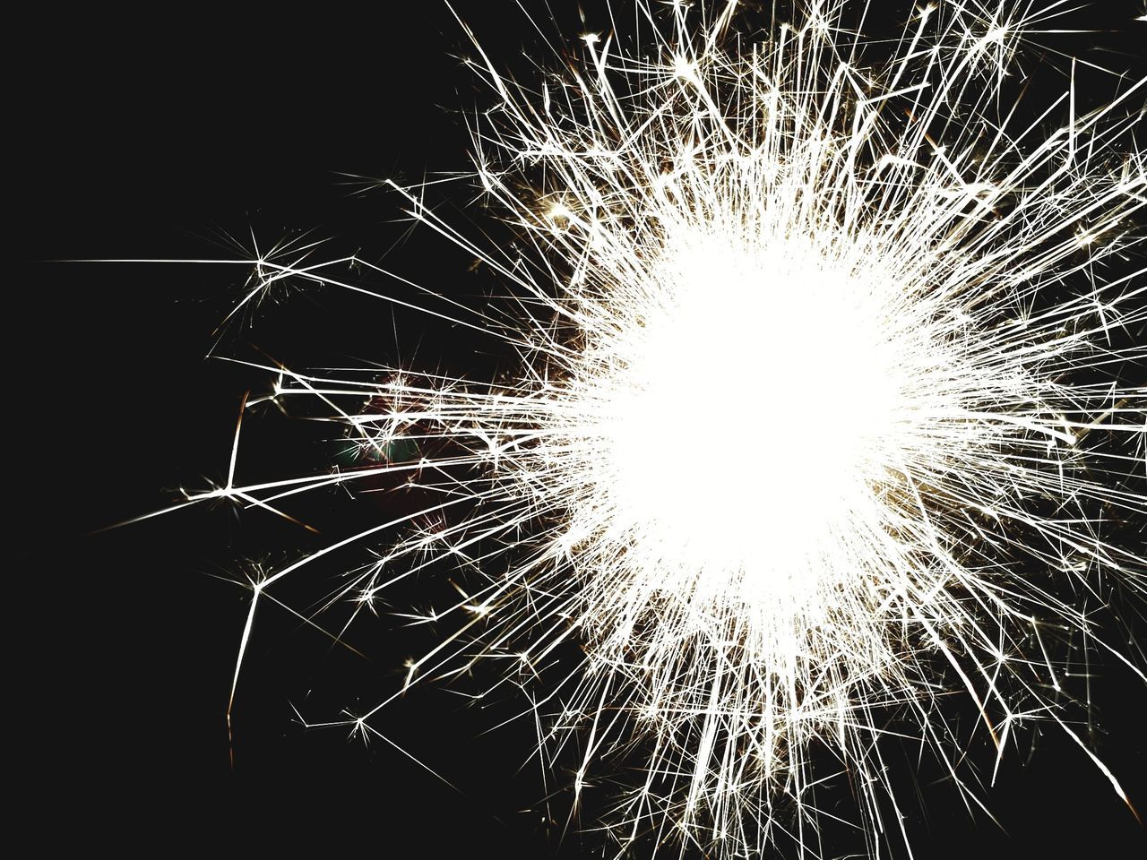 firework display, night, firework - man made object, exploding, celebration, long exposure, arts culture and entertainment, no people, close-up, event, low angle view, sparkler, firework, outdoors, illuminated, black background, sky