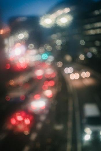 Defocused image of illuminated street at night