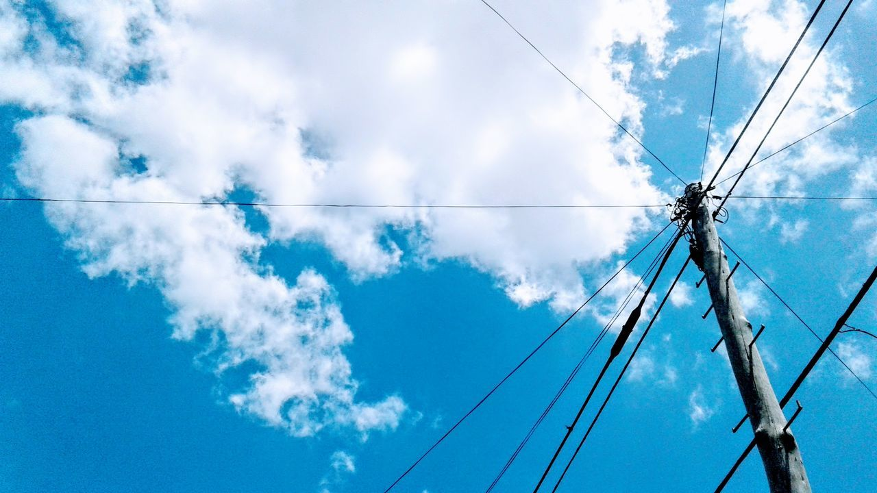 cable, low angle view, connection, power line, power supply, sky, electricity, cloud - sky, fuel and power generation, day, no people, blue, outdoors, technology, telephone line, electricity pylon, nature