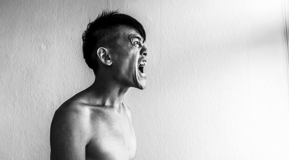 Frustrated man screaming at home