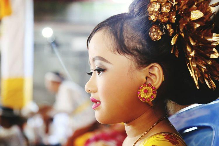 Side view of cute girl looking away