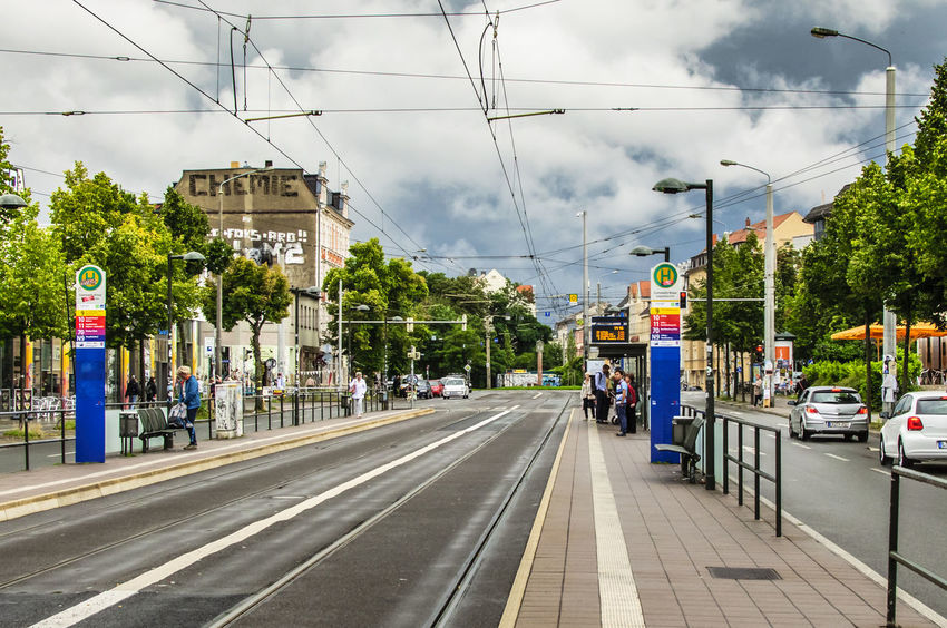 Connewitz Kreuz tram stop in Leipzig Germany. Dark Dark Clouds Dramatic Sky Tram Tram Stop Transportation Travel Architecture Built Structure Cable Car City Clouds Clouds And Sky Day Land Vehicle Mode Of Transport Platform Power Line  Real People Sky Street Tram Tracks Transportation Travel Destinations