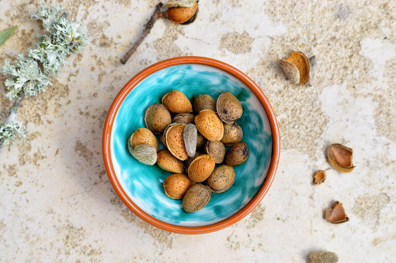 Directly Above Shot Of Almonds With Nutshells On Table