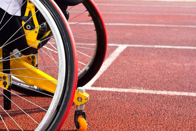 Cropped Image Of Bicycles At Sports Track