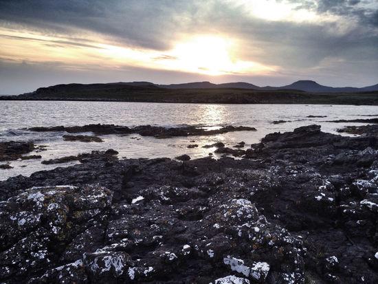 Coastline near Ullinish on the west coast of Skye Scotland Skye Beauty In Nature Cloud - Sky Highlands Highlands Of Scotland Isle Of Skye No People Rock Sea Sky Sunset Water