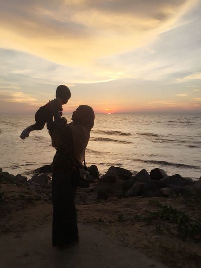 miri sarawak beach Beach Sunset Sea Water Silhouette Sky Horizon Over Water Sand Nature Real People Beauty In Nature Outdoors Scenics Men Holding Lifestyles Leisure Activity Two People Full Length Women