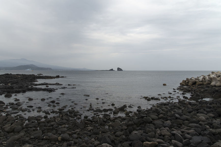 landscape around Songaksan in Jeju Island, South Korea Animal Themes Beauty In Nature Cloud - Sky Cloudy Day JEJU ISLAND  Mammal Mountain Nature No People Outdoors Pebble Pebble Beach Rock - Object Scenics Sea Seaside Sky Songaksan Tranquil Scene Tranquility Water