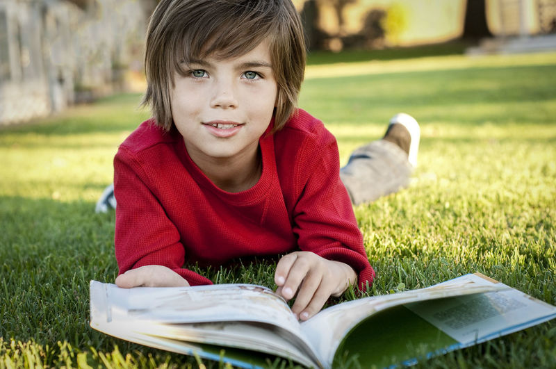 Portrait of boy on book