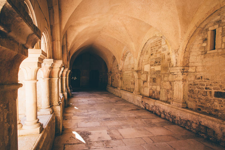 Monastery Cloister Architecture Arch The Past History Built Structure Arcade Corridor Religion Indoors  Building Travel Destinations Architectural Column Spirituality Belief No People Place Of Worship The Way Forward Direction Ancient Tourism Ancient Civilization Abbey Ceiling