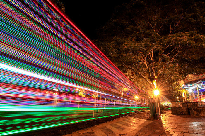 Light Trail of a train in a theme park Night Illuminated Long Exposure Light Trail Blurred Motion Outdoors Motion Sky Multi Colored No People City Architecture Johorbahru Train Dangabay Malaysia Themepark Ride Theme Park Themepark
