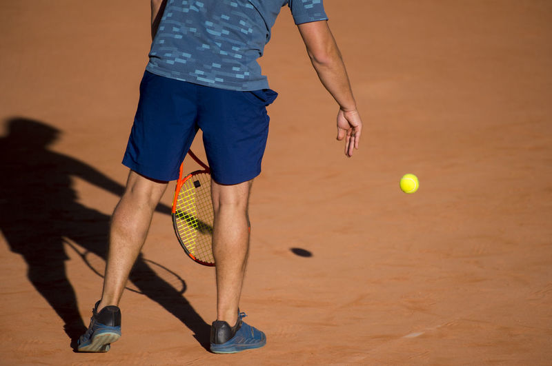 Low Section Of Man Playing Tennis