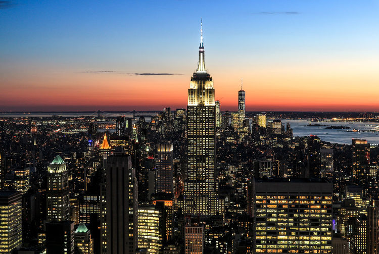 Illuminated New York Cityscape Against Sky At Sunset