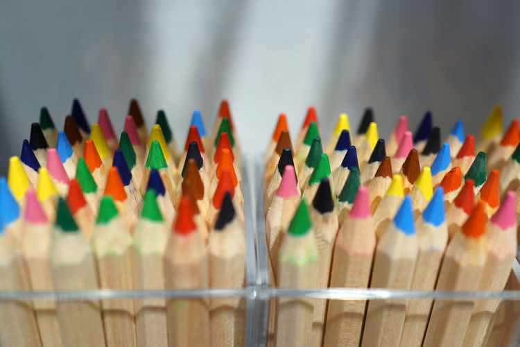 Close up macro shot of color pencil pile pencil nibs Multi Colored Variation Large Group Of Objects Choice Close-up No People Indoors  Selective Focus Art And Craft Side By Side Creativity Still Life Focus On Foreground Abundance Colored Pencil Wood - Material In A Row Pencil Arrangement Art And Craft Equipment Drawing Education Package School Equipment