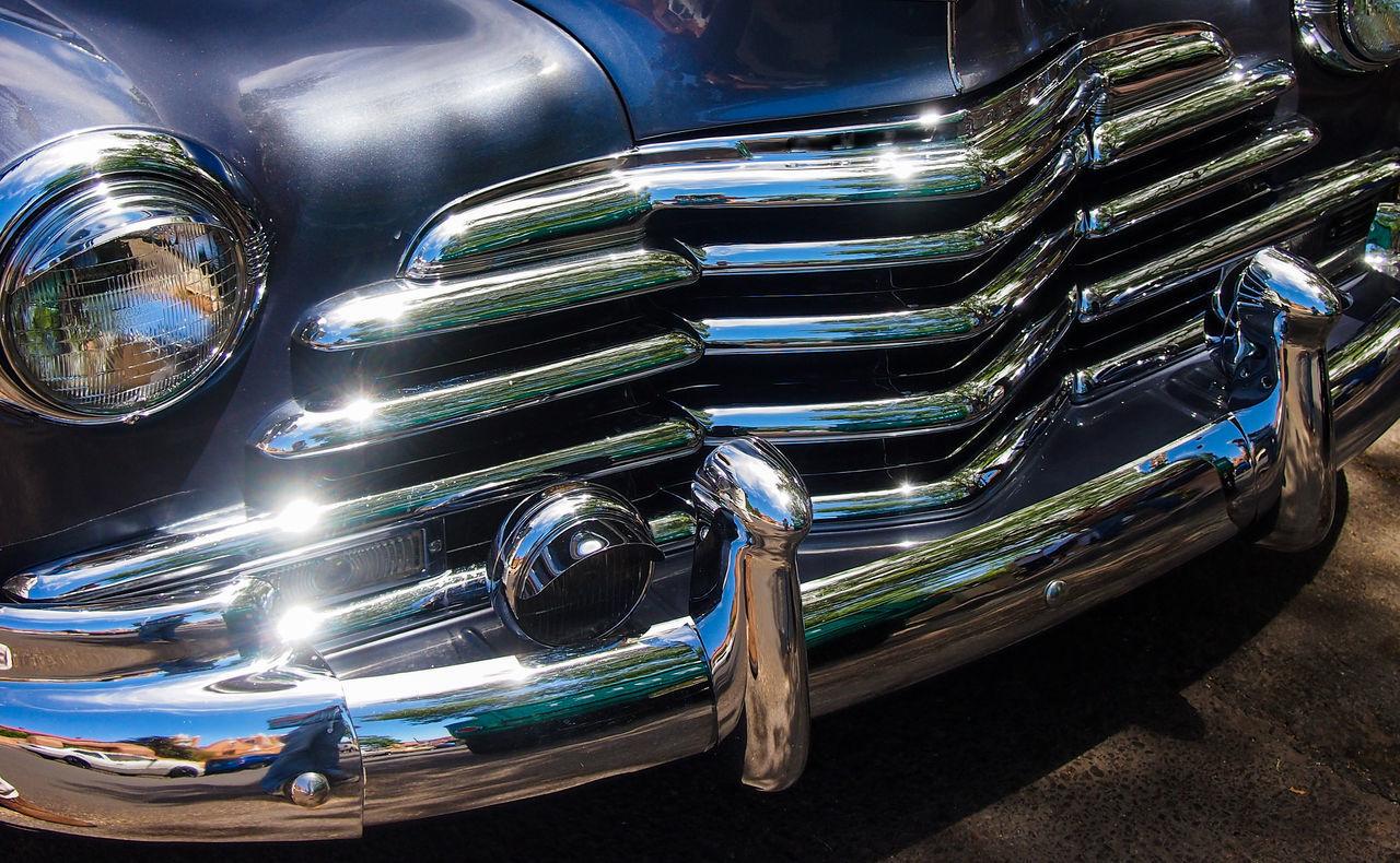 CLOSE-UP OF METALLIC CAR
