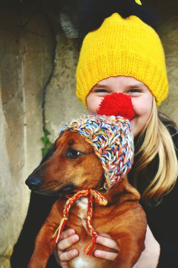 Portrait of smiling girl with dog outdoors