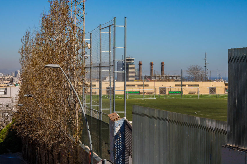 Sky Clear Sky Outdoors Growth Architecture No People Tree Built Structure Grass Day Nature Football Football Field Soccer Soccer Field Chimney Skatepark Beautiful Cityscape Barcelona Clear Sky Travel Destinations Building Exterior Portrait Of A City Skyline Neighborhood Map