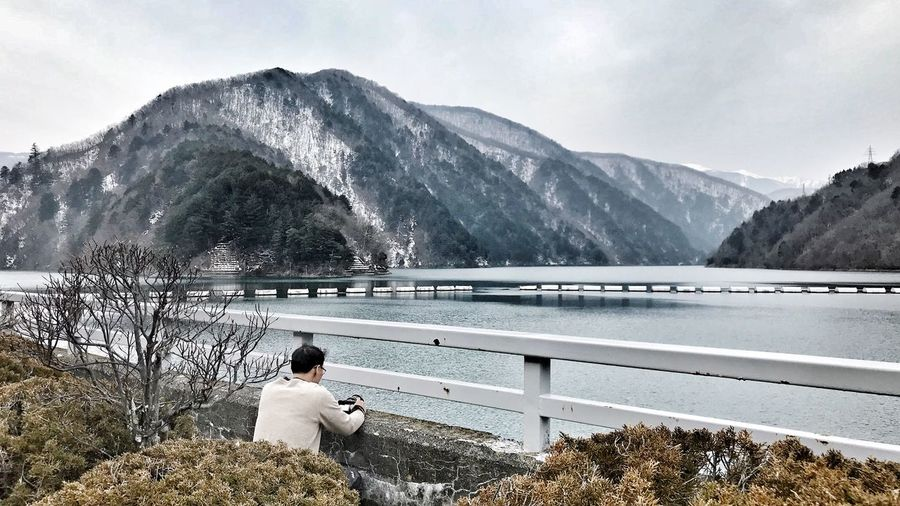 a place between road trip Road Trip Japan Dam Mountain Snow Cold Temperature Beauty In Nature Winter Domestic Animals Lake Scenics Nature Outdoors Snowcapped Mountain Water Sky