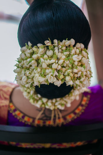 Rear view of woman with pink flowers