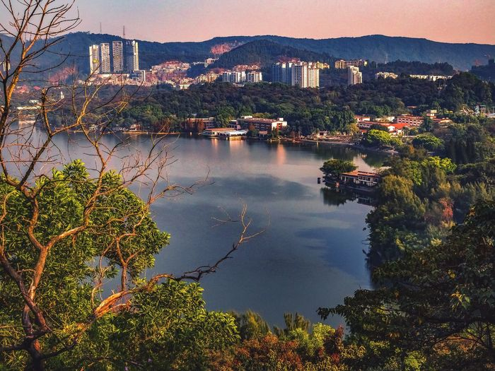 Baiyun Lake View City Water Cityscape Sunset Outdoors Tree Residential Building No People Sky Guangzhou Landscape Beauty In Nature Tranquility Nature Scenics Nature Mountain Day Landscapes Lake Side Top Perspective Baiyun Mountain China Top Of Pagoda