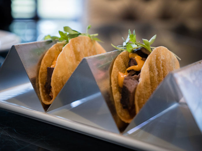 Close-up of tacos on metal container