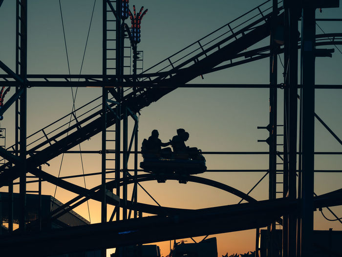 Hamburger Dom - roller coaster Roller Coaster Funfair Roller Coaster Ride Connection Built Structure Architecture Occupation Sky Silhouette Real People Transportation Men Bridge Working Low Angle View Nature Group Of People Bridge - Man Made Structure Technology Cable Outdoors Engineering Sunset