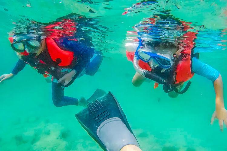 People snorkeling in sea