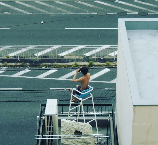 One Person Day Lifestyles Adult Adults Only Chair Leisure Activity People Young Adult Sitting Outdoors Moment In Time EyeEm Best Edits My Unique Style Eyeemphotography Cityview Building Exterior Modern Osaka 大阪 Shinseikai Scenics EyeEmbestshots No People Citylife EyeEm Gallery