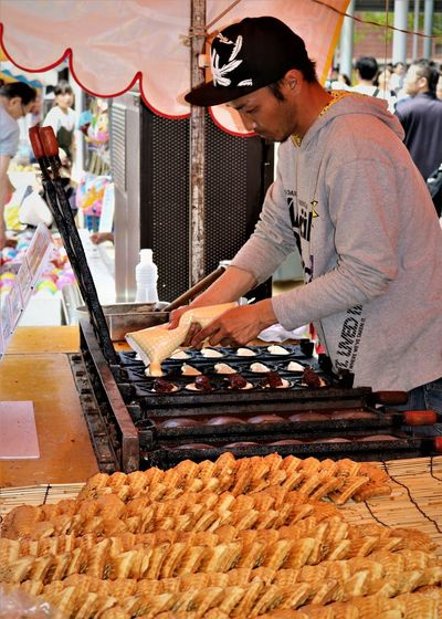 Taiyaki Stall, Hiroshima Flower Festival Hiroshima Flower Festival Adult Cooking Day Festival Foods Flower Festival Food Freshness Hot Plate Japanese Food Japanese Garden Japanese Style One Man Only One Person People Real People Retail  Rows Of Things Snack TAIYAKI Working Working Hard Young Adult たい焼き The Street Photographer - 2017 EyeEm Awards The Portraitist - 2017 EyeEm Awards Neighborhood Map Visual Feast Food Stories Small Business Heroes