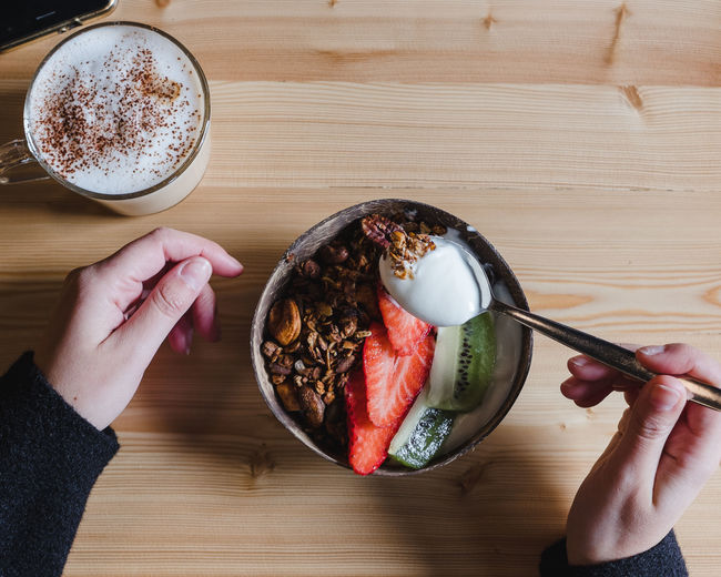 Food And Drink Human Hand Food Hand Table Human Body Part Freshness One Person Real People Holding Refreshment Drink Indoors  Cup Healthy Eating Wellbeing Lifestyles Directly Above High Angle View Body Part Finger Meal Breakfast