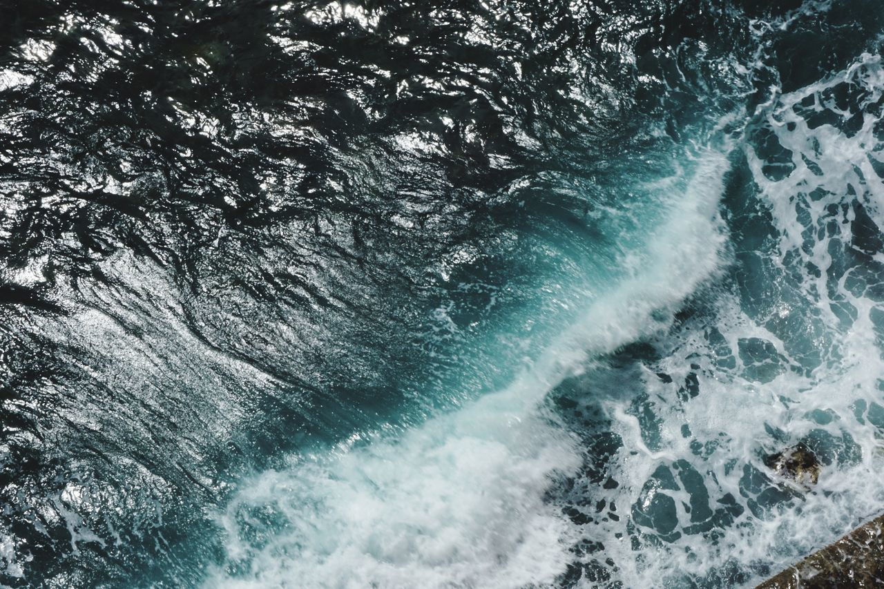water, motion, wave, sport, beauty in nature, sea, aquatic sport, surfing, nature, waterfront, power in nature, scenics - nature, day, power, outdoors, full frame, blurred motion, high angle view, flowing water